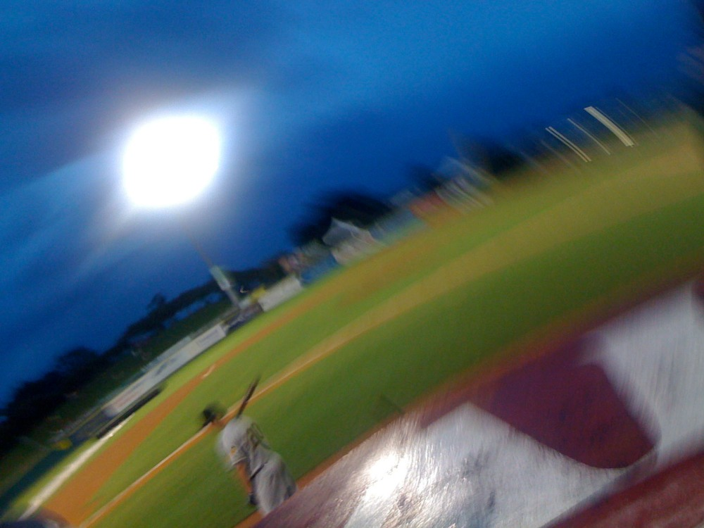 Blurry Baseball Field and Player
