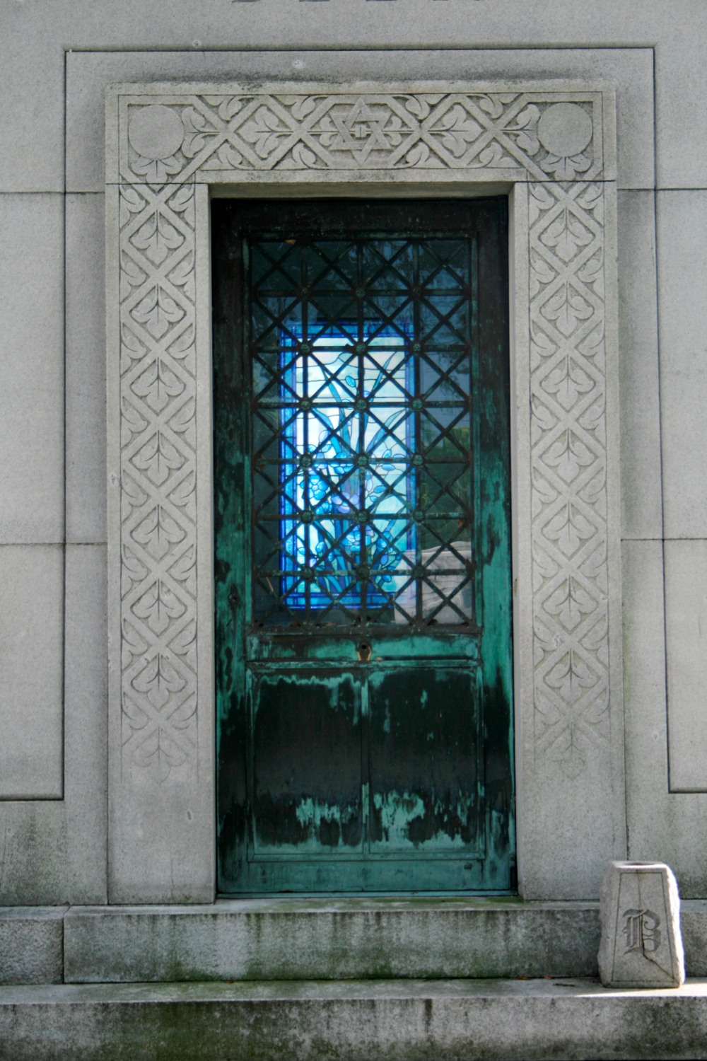 blue glass and copper door