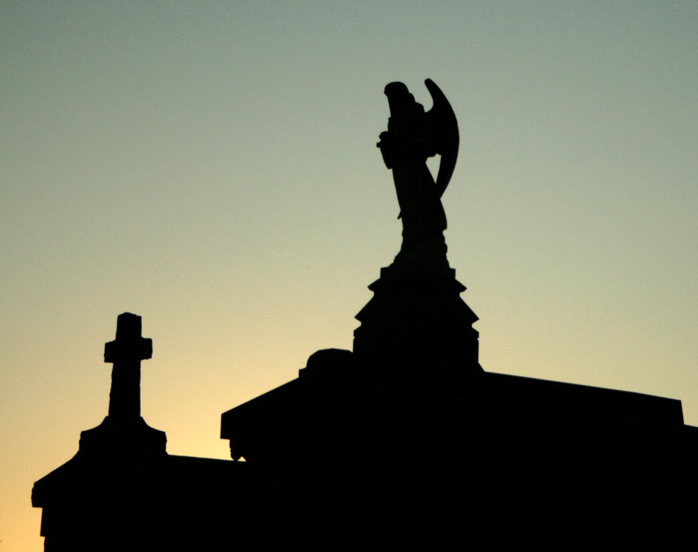 angel and cross silhouettes